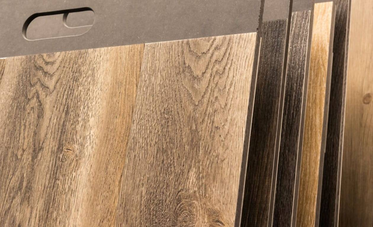 rows of vinyl flooring in different finishes and colours